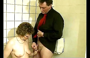 A really old dirty granny performing a jawbreaking oral