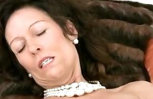 Intense cougar orgasm from dildo