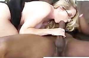 Mature cougar gets interracial with big black cock