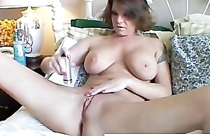Big tits MILF shaves her down in the mouth pussy