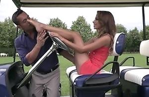 Cute lady does footjob on golf room till cum