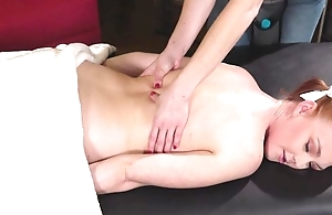Cute redhead dame acquires enticed and drilled by her unnatural masseuse