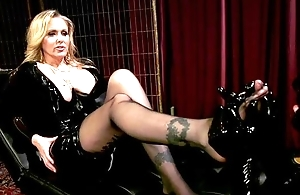 Dominant MILF with big juggs plays with her disparate slave