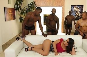 Young latina with eroded nipples enjoys interracial gangbang